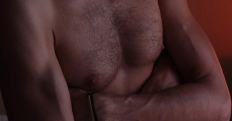 Male chest. Sensual nipple massage